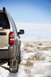 SUV na estrada a em nenhuma parte Imagem de Stock Royalty Free