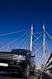 SUV on Nelson Mandela Bridge. Luxury black SUV driving across the Nelson Mandela bridge Stock Photos