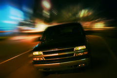 SUV in night city Stock Photography