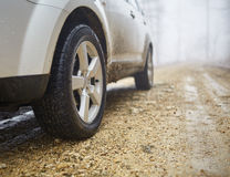 SUV offroad on a foggy day Royalty Free Stock Photography