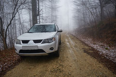 SUV offroad on a foggy day Royalty Free Stock Images