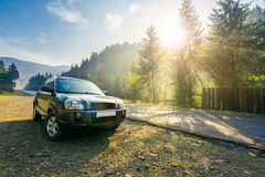 Free SUV On Countryside Road In Foggy Mountains Stock Photo - 125571430