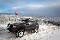 Suv op sneeuw Stock Afbeelding