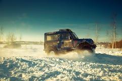 SUV op sneeuw Royalty-vrije Stock Foto