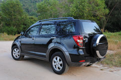 Suv at outdoor. Suv driving offroads in a natural terrain Royalty Free Stock Photography