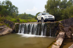 SUV over the weir. Chevrolet Captiva standing in water at weir Royalty Free Stock Photo
