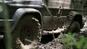 SUV overcome difficult dirty section offroad in 4x4 expedition stock video footage