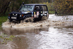 SUV overcome water obstacles. Royalty Free Stock Images