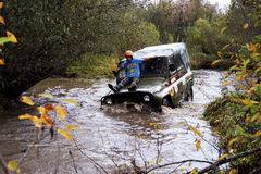 SUV overcome water obstacles. Stock Photography