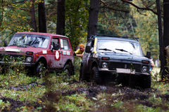 SUV overcomes mud obstacles. Royalty Free Stock Photo
