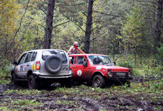 SUV overcomes mud obstacles. Stock Image