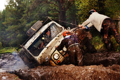SUV overcomes mud obstacles. Royalty Free Stock Image