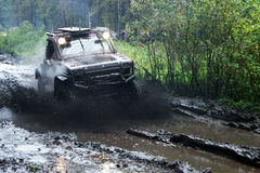 SUV overcomes mud obstacles. Stock Images