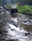 SUV overcomes mud obstacles. Royalty Free Stock Photos