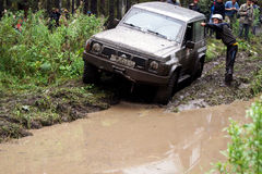 SUV overcomes mud obstacles. Stock Photography