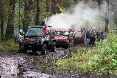 SUV overcomes mud obstacles. Stock Photos