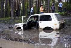 SUV overcomes mud obstacles. Stock Photo
