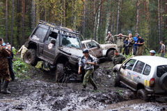 SUV overcomes mud obstacles. Royalty Free Stock Photography
