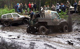SUV overcomes mud obstacles. Royalty Free Stock Images
