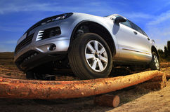 SUV overcomes obstacle Stock Photography