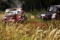 SUV overcomes the swamp. Stock Photos