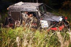 SUV overcomes the swamp. Stock Image