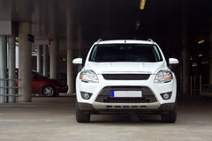 SUV on a parking lot. A compact white SUV on a parking lot. Front view Royalty Free Stock Photos
