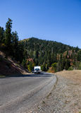 SUV Pulling RV in Mountains Stock Photo