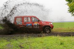 SUV Rally on a dirt road through the fields Stock Images
