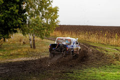 SUV Rally on a dirt road between the forest and field Royalty Free Stock Photo