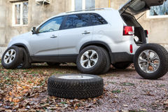 Suv ready for wheel changing before winter season. Suv ready for wheel changing before a winter season Stock Photos