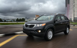 The SUV rides on city streets stock photos