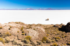 SUV riding salt desert Salar De Uyuni islands landscape stock photography