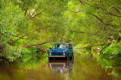 SUV in river Royalty Free Stock Photo