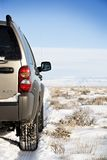 SUV on the road to nowhere Royalty Free Stock Image