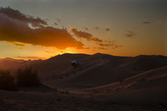SUV in safari desert. With sunset on the sky with clouds royalty free stock photos