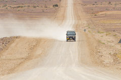 SUV in the scenic road C12 to Fish River Canyon, Namibia Royalty Free Stock Images