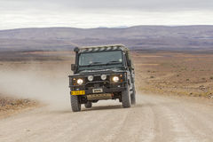 SUV in the scenic road C12 to Fish River Canyon, Namibia Royalty Free Stock Photo