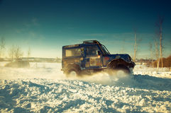 SUV on snow Royalty Free Stock Photo