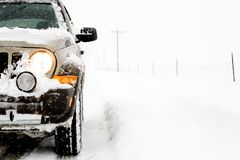 SUV in snow stock photography