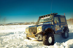 SUV on snow Royalty Free Stock Photography