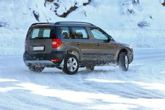 SUV in the snow Stock Images
