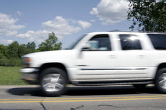 SUV on speed Royalty Free Stock Images