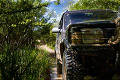 SUV Sport Utility Vehicle with 4 x 4 off road on muddy track stock photos