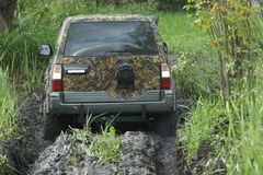 SUV in a swamp Royalty Free Stock Photos