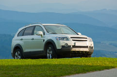 SUV on top of a mountain Stock Image