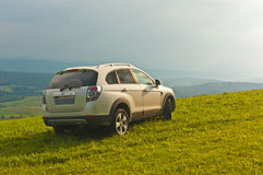 SUV on top of a mountain Royalty Free Stock Photo