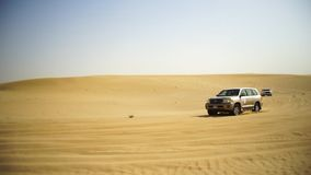SUV Trip for tourists in the desert. Stock. Group of people driving off road car in the Vietnam desert during a safari stock photos