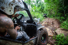 SUV in the tropical jungle - March 7, 2013 Adventure car enthusiast wading a rocky river  using modified four wheel car Stock Images