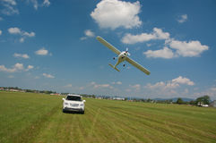 SUV and ultralight aircraft departing Stock Photo